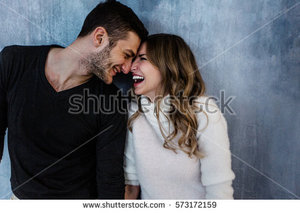 stock-photo-young-couple-in-love-have-fun-i-on-new-years-eve-or-st-valentines-day-573172159.jpg